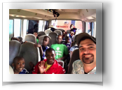 In the Agape bus with visitor.jpg
